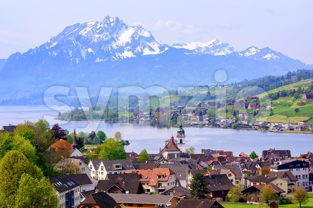 Little swiss town on Lake Lucerne and Pilatus mountain, Switzerland Stock Photo