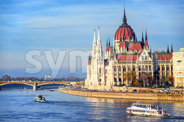 Cruise ships going by Parliament building down the Danube river, Budapest, Hungary
