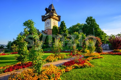 The historical Clock tower Uhrturm in the city park, Graz, Austria Stock Photo