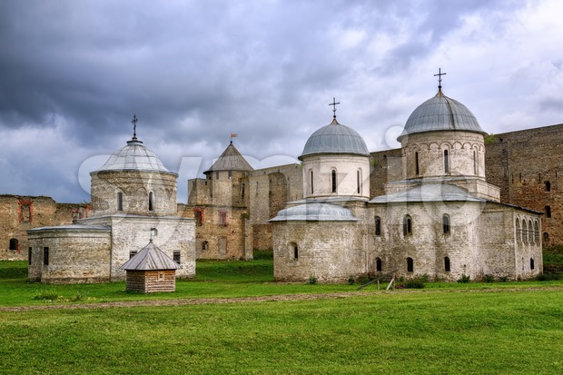 Russian orthodox churches inside the walls of Ivangorod Fortress on Russia - Estonia border on a dark stormy day