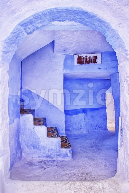 Entrance to the traditional blue painted house in the old town of Chaouen, Morocco