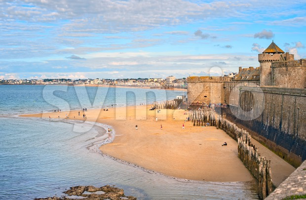 Atlantic beach under the towers of city walls in St Malo in English Channel, Brittany, France
