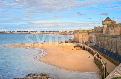 Atlantic beach under the towers of city walls in St Malo, Brittany, France Stock Photo