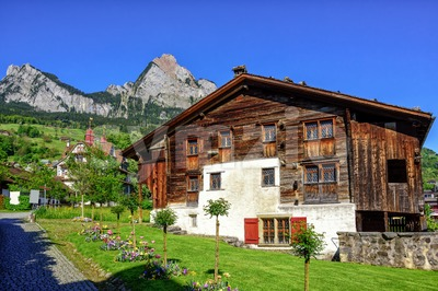 Traditional wooden swiss house in Schwyz, Switzerland Stock Photo