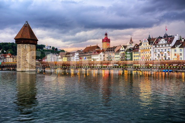Chapel Bridge and Water town in the old town of Lucerne on dramatic sunset, Switzerland