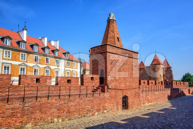 Gunpowder Tower and red brick walls of the historical Warsaw Barbican fort, Poland