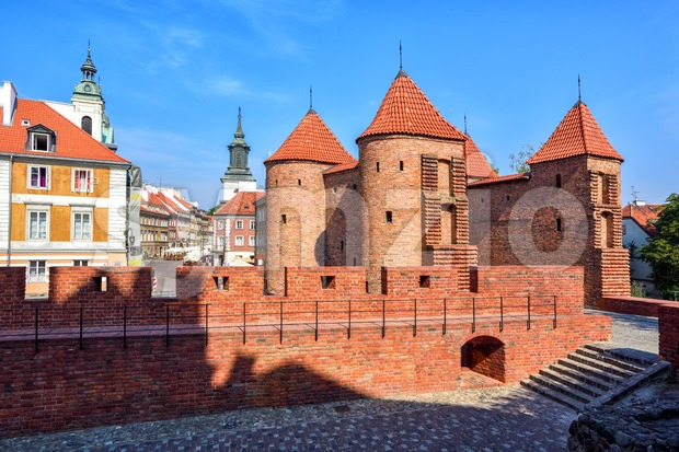 Towers and red brick walls of the historical Warsaw Barbican fort, Poland