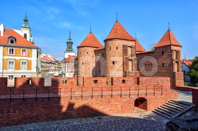 Red brick walls and towers of Warsaw Barbican, Poland Stock Photo