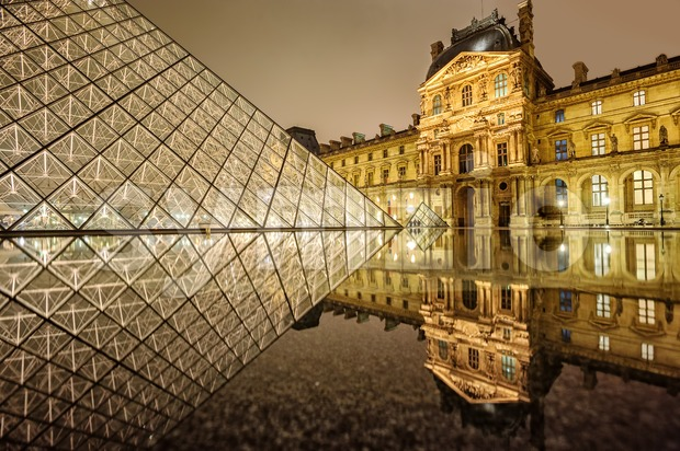 Louvre museum and glass Pyramid at night, Paris, France Stock Photo