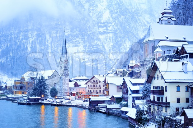 Hallstatt wooden village on lake in snow white, Austria Stock Photo