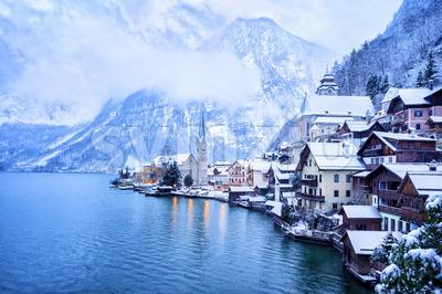 Hallstatt wooden village on lake in snow white, Austria Stock Photo