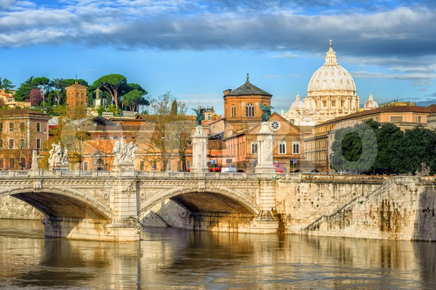 Bridge over Tiber river and Dome of St. Peter Cathedral in Vatican City, Rome, Italy
