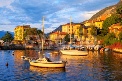 Yachts in a harbour on Lake Como, Italy, on sunset Stock Photo