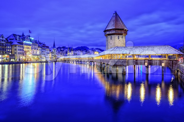 Lucerne Old Town, Switzerland, with wooden Chapel Bridge over Reuss River, the Water Tower and promenade on a blue winter ...