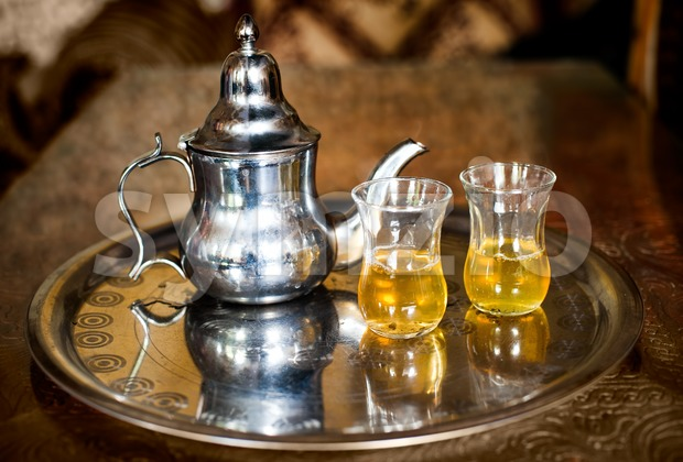 Set of arabic nana mint tea with metal tea pot and glasses Stock Photo