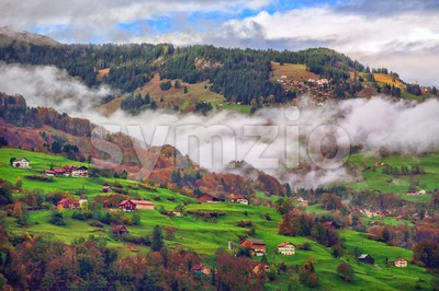 Switzerland Alps mountain misty landscape with clouds Stock Photo