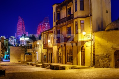 Baku Old Town and Flame Towers at night, Azerbaijan Stock Photo