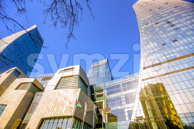 Low angle perspective view of the Flame Towers, modern glass facade skyscrapers, Baku, Azerbaijan