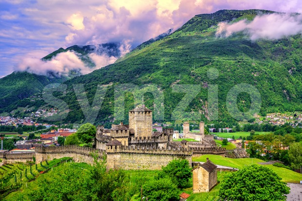 Castello di Montebello in the medieval Old Town of Bellinzona, Switzerland, Alps mountains, in dramatic sunset light