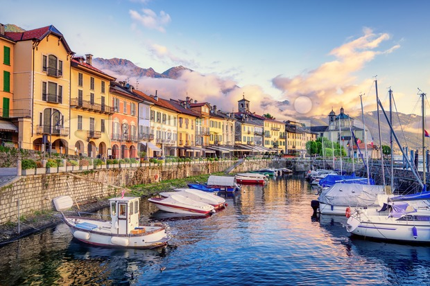 Port in the Old Town of Cannobio, Italy, a famous tourist resort on Lago Maggiore lake, in dramatic sunset light