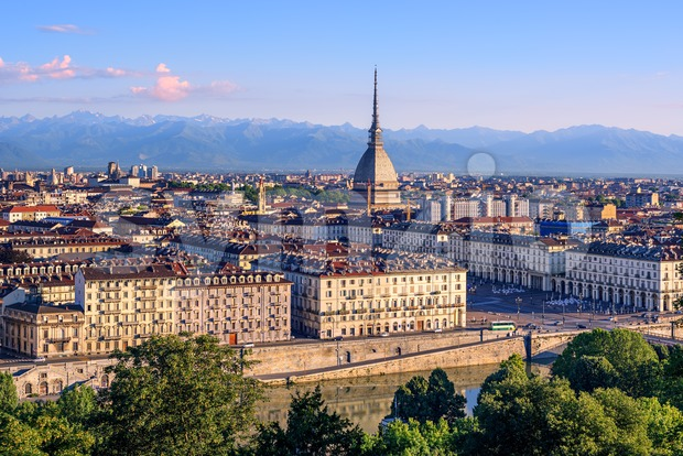 The city center of Turin with Mole Antonelliana tower, Alps mountains panorama and Po river embankment, Turin, Italy