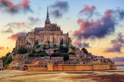 Mont Saint Michel island, Normandy, France, on sunset Stock Photo