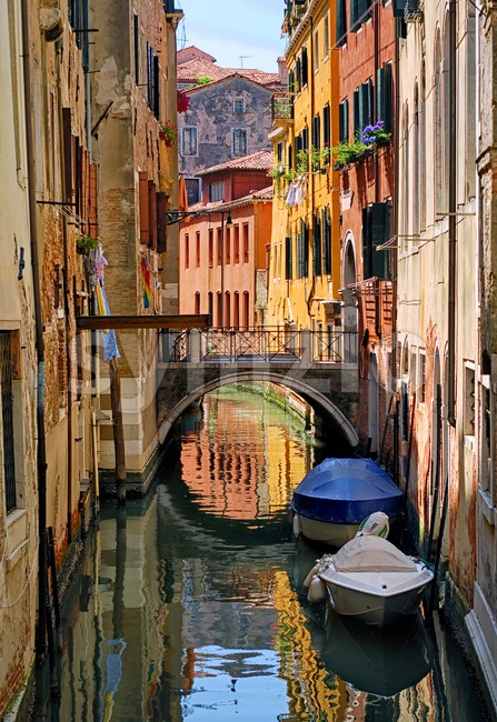 Narrow channel street in Venice, Italy Stock Photo