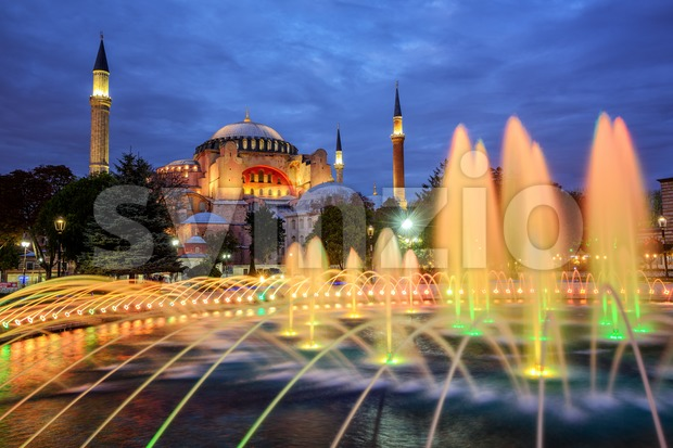 Hagia Sophia basilica in Istanbul, Turkey, with colorful illuminated fountains on late evening