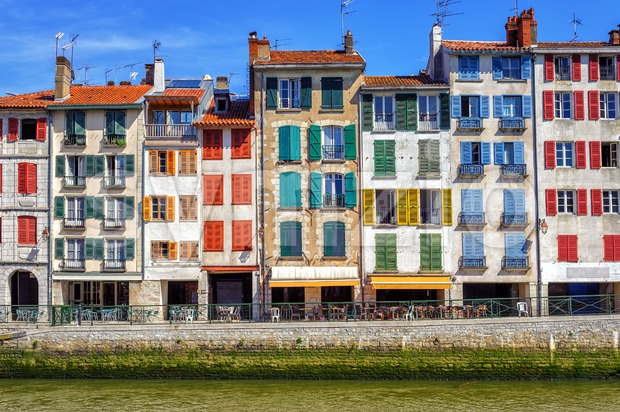 Traditional facades with coloful windows in Bayonne, Basque Country, France