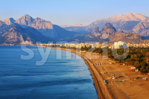 Konyaalti sand beach and Taurus mountains in the early morning light, Antalya, Turkey Мediterranean coast