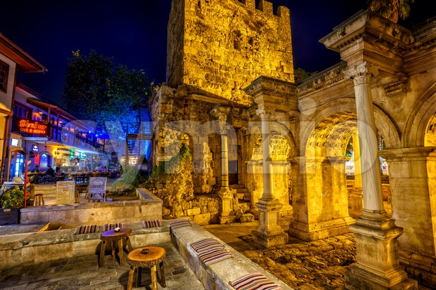 Antalya, Turkey - October 12: The antique roman Hadrian's Gate is a popular tourist attraction with many cafes and restaurants ...