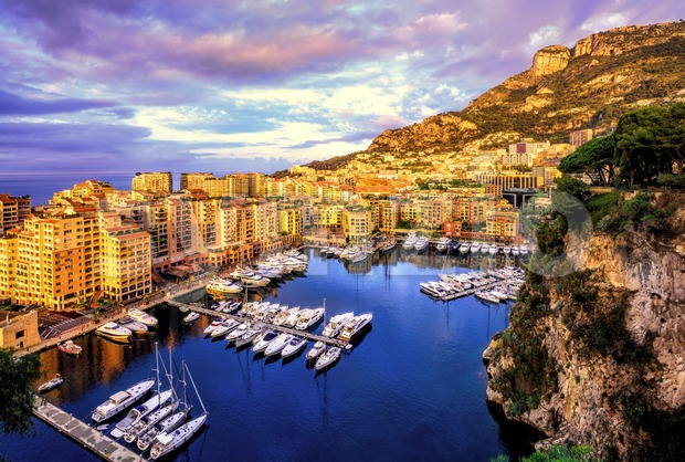 Port Fontvieille harbour in Old Town of Monaco with luxury yachts and apartments on sunrise