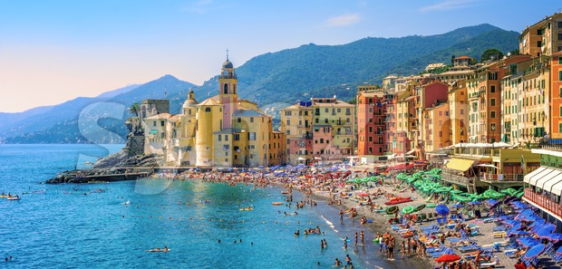 Panoramic view of historical Old Town Camogli and sand beach on mediterranean coast in Camogli, italian Riviera, Italy