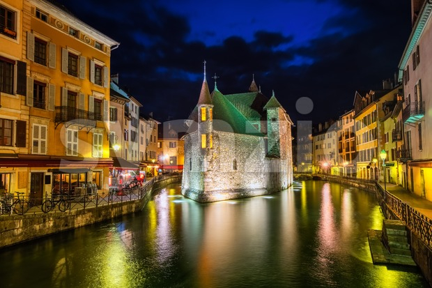 Historical Old Town of Annecy with Palais de l'Isle on a river island, France, illuminated at night