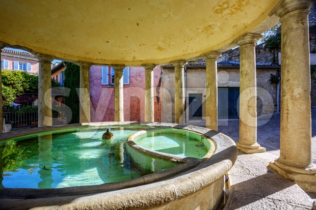 The neo-classical washhouse fountain in the beautiful village Grignan, Drome provencal, France