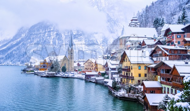 Historical Hallstatt town on a lake in Alps mountains, Austria, snow covered in winter time, is on UNESCO World Culture ...