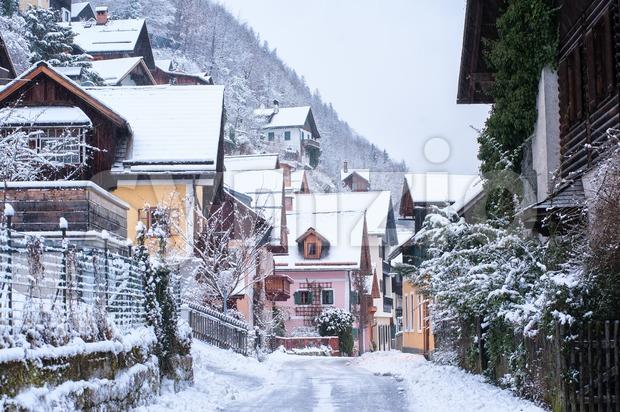Snow white winter time in Hallstatt Old Town, Austria, Alps mountains