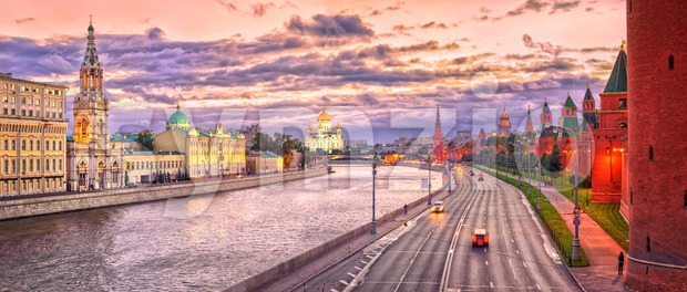 Panoramic view of Moscow Kremlin walls, Christ the Saviour Cathedral and Moskva River in red evening light, Moscow, Russia