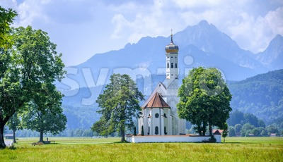 Landscape with white church and Alps mountains, Germany Stock Photo
