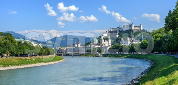 Panoramic view of Salzburg Old Town, Hohensalzburg castle, Salzach river and Alps mountains on a sunny summer day, Austria. Salzburg ...
