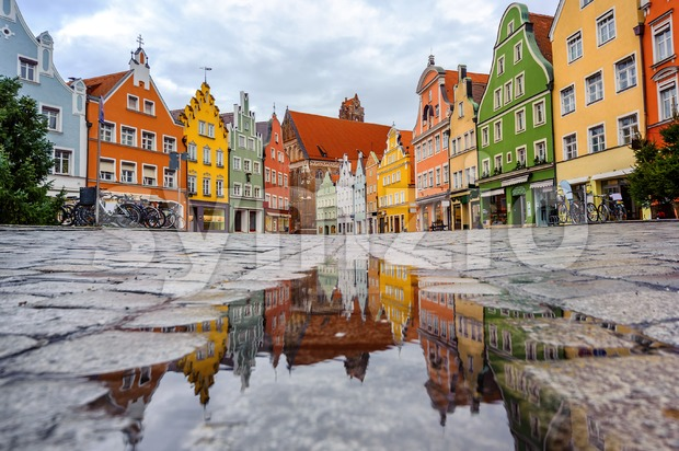 Traditional colorful gothic houses in the Old Town of Landshut, historical town in Bavaria by Munich, Germany, reflecting in a ...