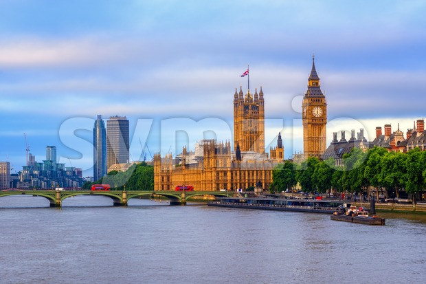 London, England, the Big Ben, the Houses of Parliament, Westminster bridge and Thames river on sunrise