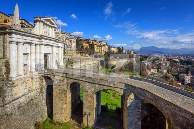 Bridge and Porta San Giacomo gate on the city walls of the Upper Old Town of Bergamo, Citta Alta, Italy