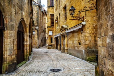 Narrow street in the Old Town of Sarlat, Perigord, France Stock Photo