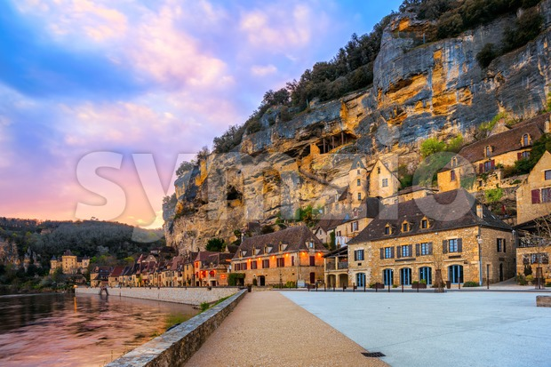 La Roque-Gageac, one of the most beautiful villages of France (Les Plus Beaux Villages), in dramatic sunset light. Roque Gageac ...