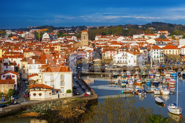 Traditional basque houses in the Old Town of Saint Jean de Luz, France Stock Photo