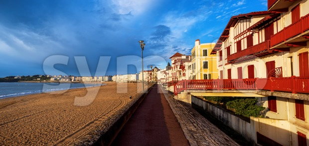 Traditional colorful basque timber houses facing the sand beach in St Jean de Luz, Atlantic ocean coast, France
