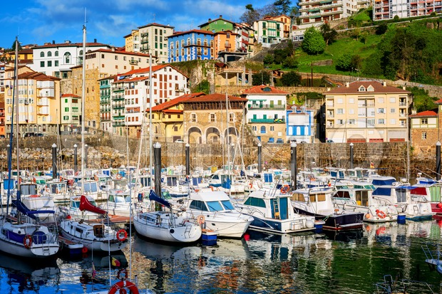 Colorful houses and white sail boats in Mutriku port and old town, Basque country, Spain