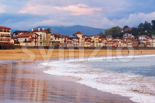 Traditional basque timber houses facing sand beach in Saint Jean de Luz, a resort town on Atlantic coast, Bay of ...