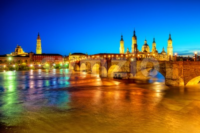 Zaragoza city, Spain, view over river to Cathedral at sunset Stock Photo